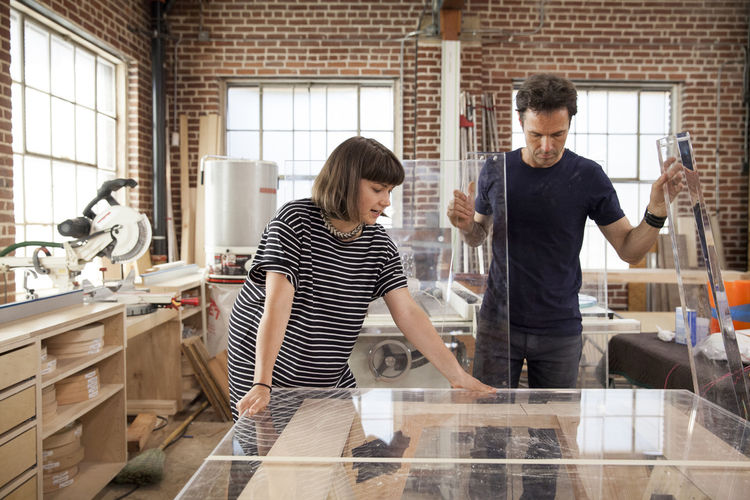 Ellen's Design Challenge winners, designer Katie Stout and carpenter Karl Champley, build the acrylic desk from scraps found at a salvage yard to win the top design for week five of the HGTV show