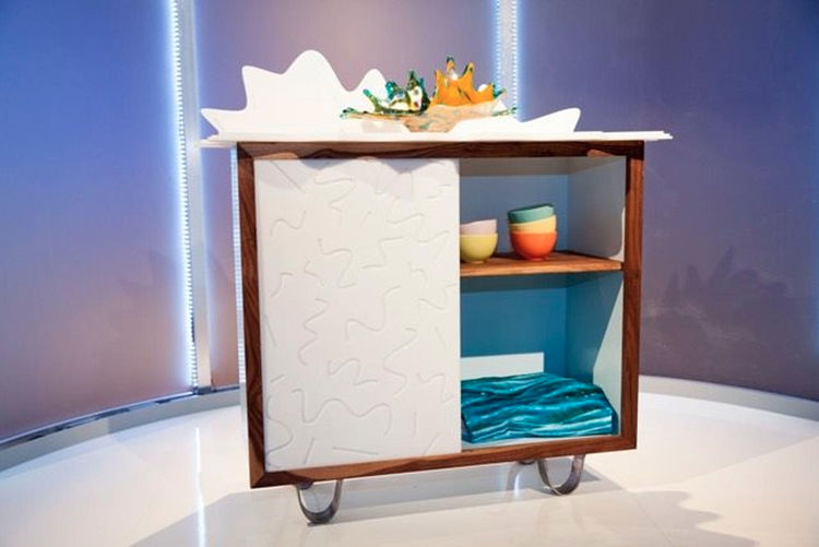 Ellen's Design Challenge winners, designer Katie Stout and carpenter Karl Champley, created this sideboard cabinet made of steel, walnut and acrylic for Challenge One of the HGTV show