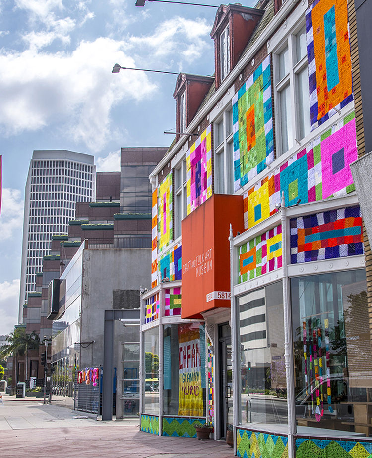 The Mid-Wilshire district in Los Angeles got a colorful eye-full when Yarn Bombing Los Angeles covered this museum in yarn