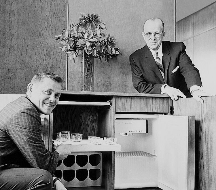 Westye Bakke and his son Bud Bakke show a mini refrigerator.