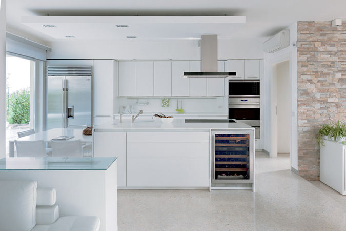 The sleek, modern design of Sub-Zero and Wolf products work seamlessly with this all-white kitchen.