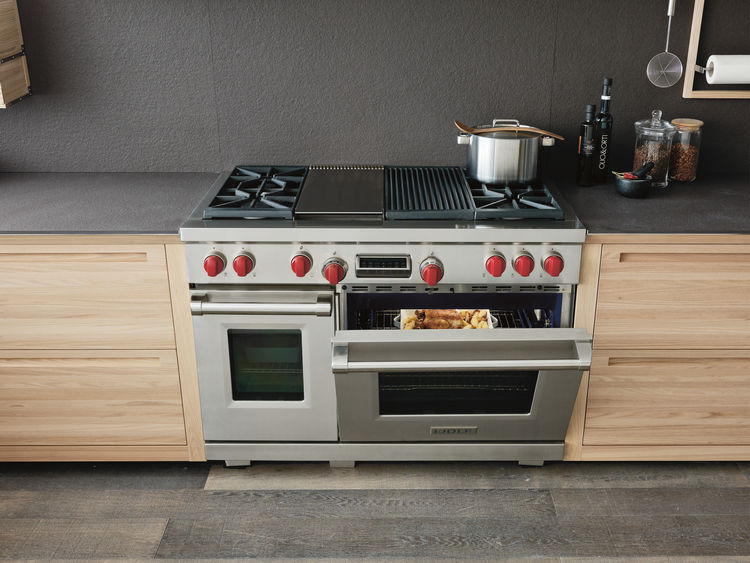 "Wolf 48"" Gas Range with four dual-stacked burners, gas convection oven, and infrared broiler."