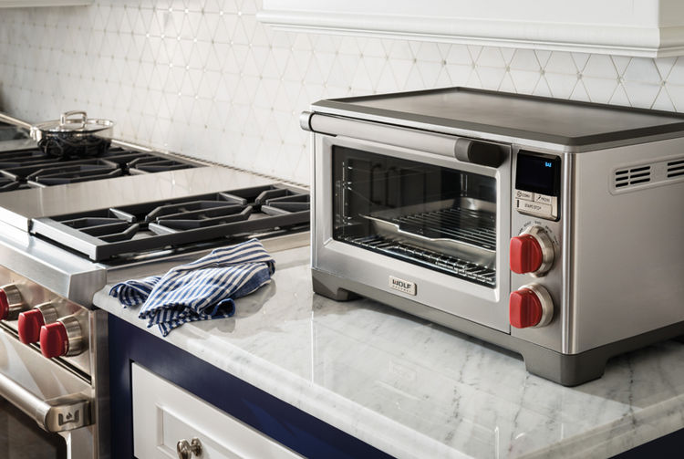 Wolf Gourmet countertop oven with convection has an integrated temperature probe for predictable baking, roasting, and broiling results.