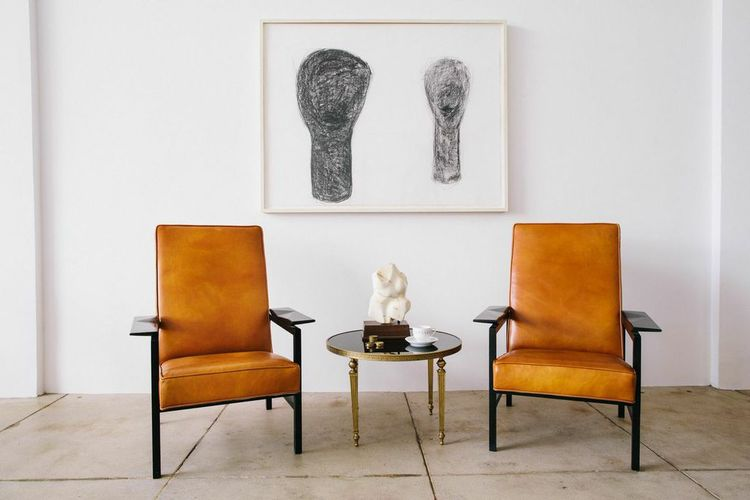 At Outfit Home in Los Angeles, a line drawing by Jene Highstein joins vintage leather chairs.