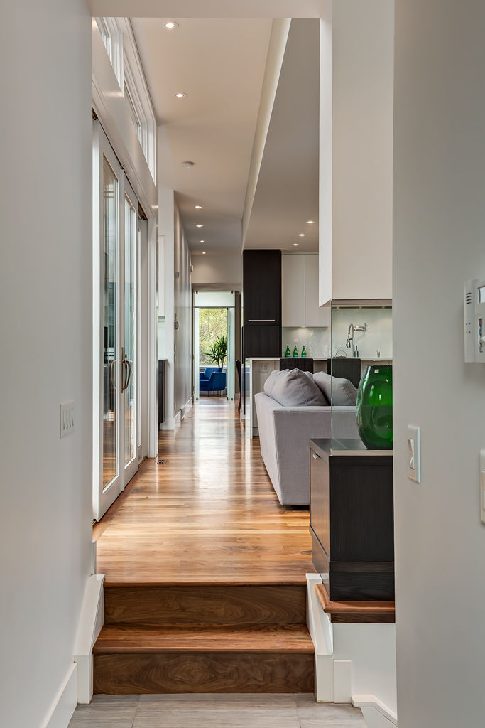 Wide hallways of Calgary bungalow designed by DOODL.