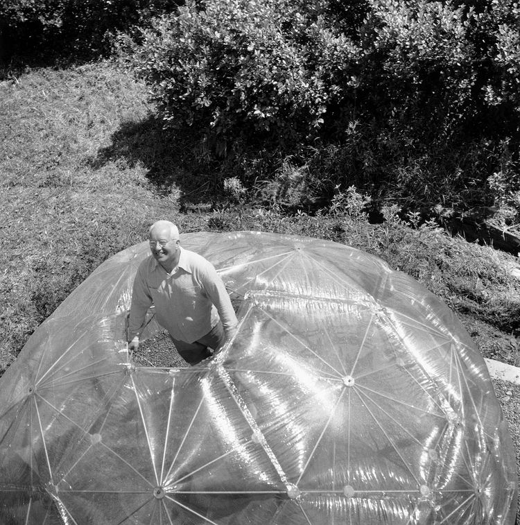 Fuller inside his Geodesic Dome.