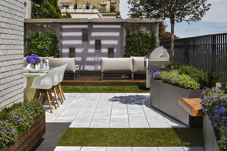 Roof terrace with limestone pavers and Astroturf