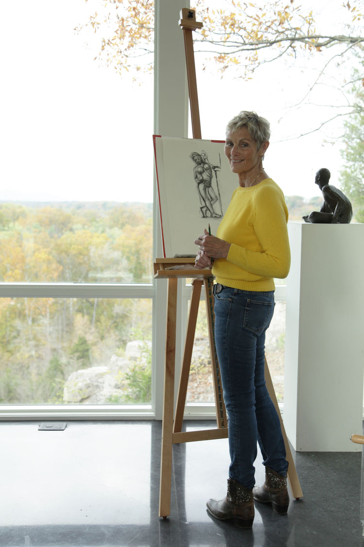 Loraine Strait in her creative space, overlooking the Potomac River.