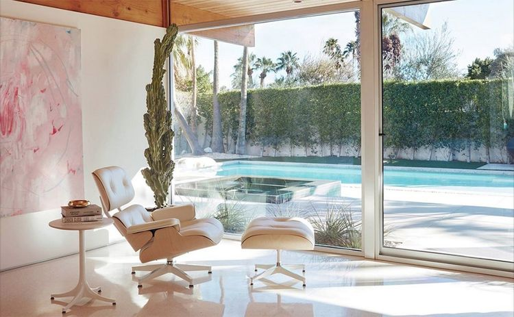 The Eames Lounge and Ottoman in a 1950s Palm Springs house designed by Donald Wexler