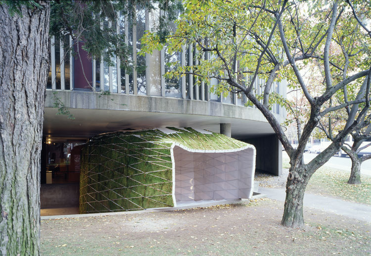 Moss-covered prefab theater.