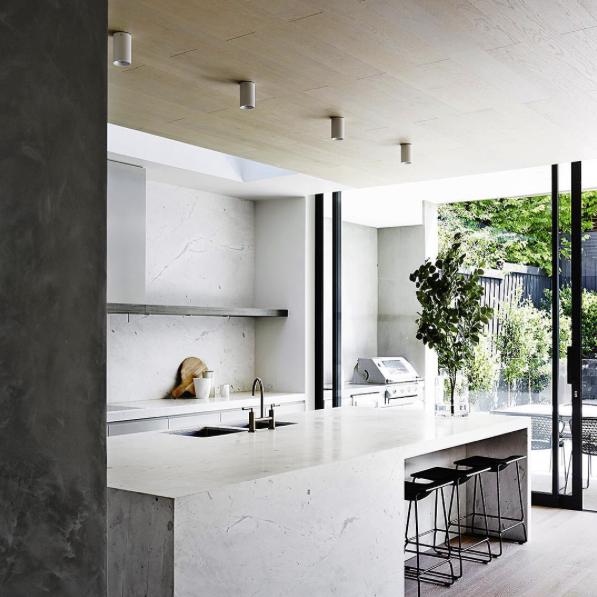Minimalist kitchen by Mim Design Studio with an indoor/outdoor divide