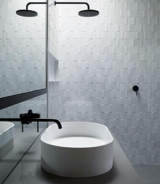 Black fixtures and white tile in a modern bathroom