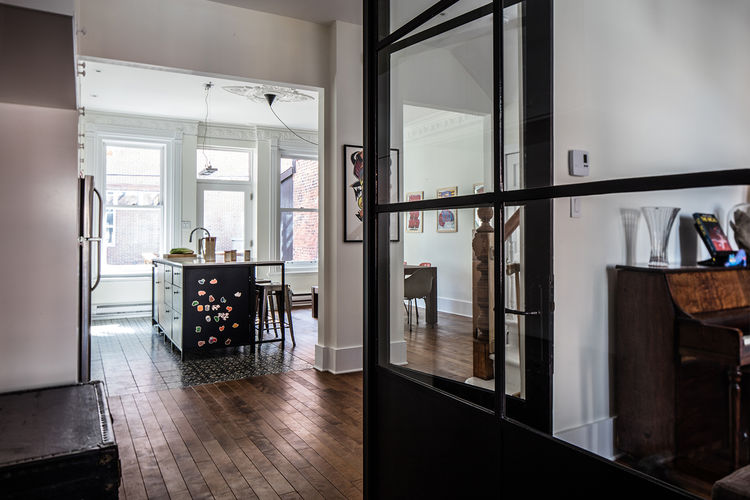Montreal heritage house with a glass partition