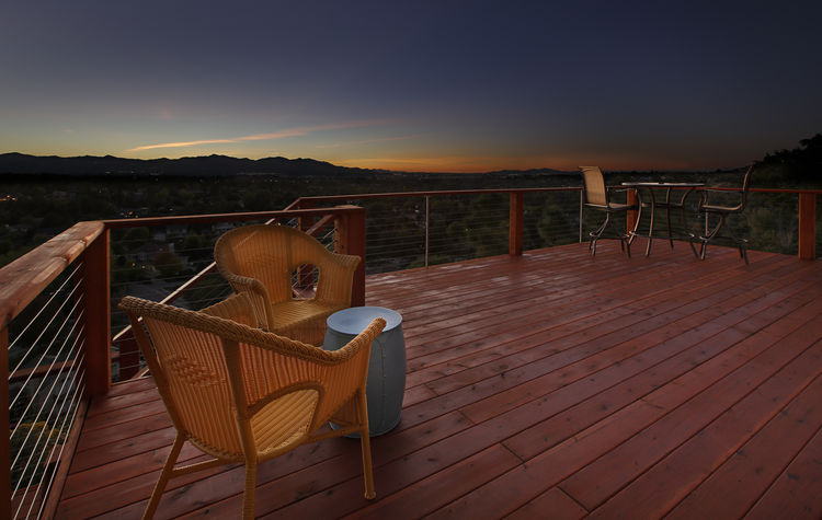 An evening view from a redwood deck