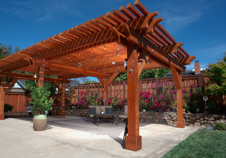 A redwood pergola on a backyard patio