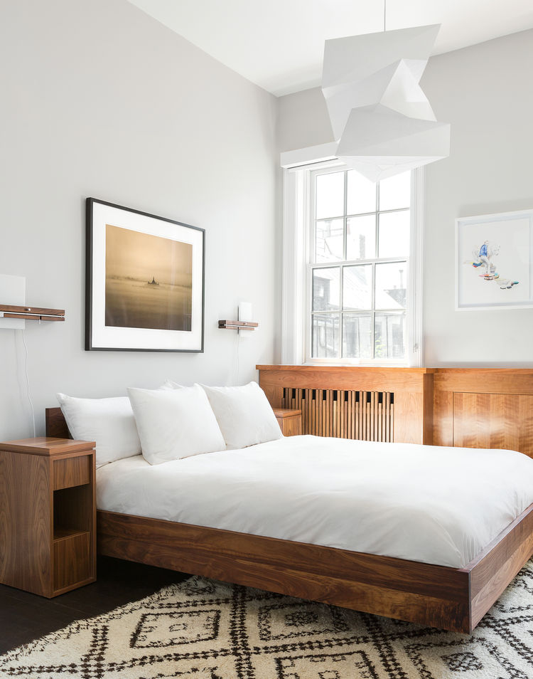 Bedroom in a West Village apartment with a Noguchi pendant