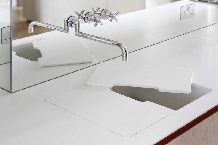 A custom sink with a removable cutting board