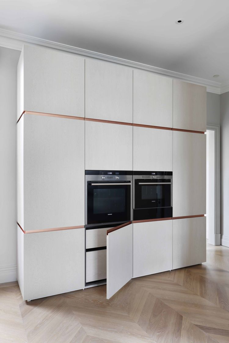 Built-in storage and appliances at a London flat