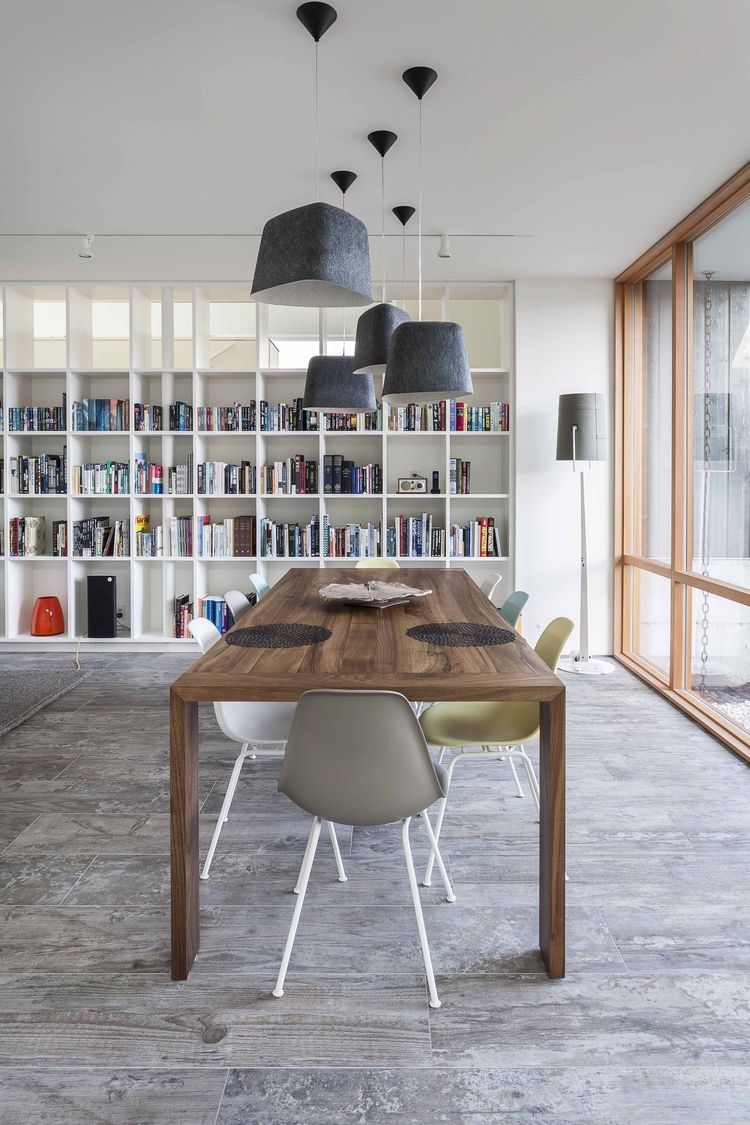 A Ligne Roset Eaton dining table surrounded by Eames chairs