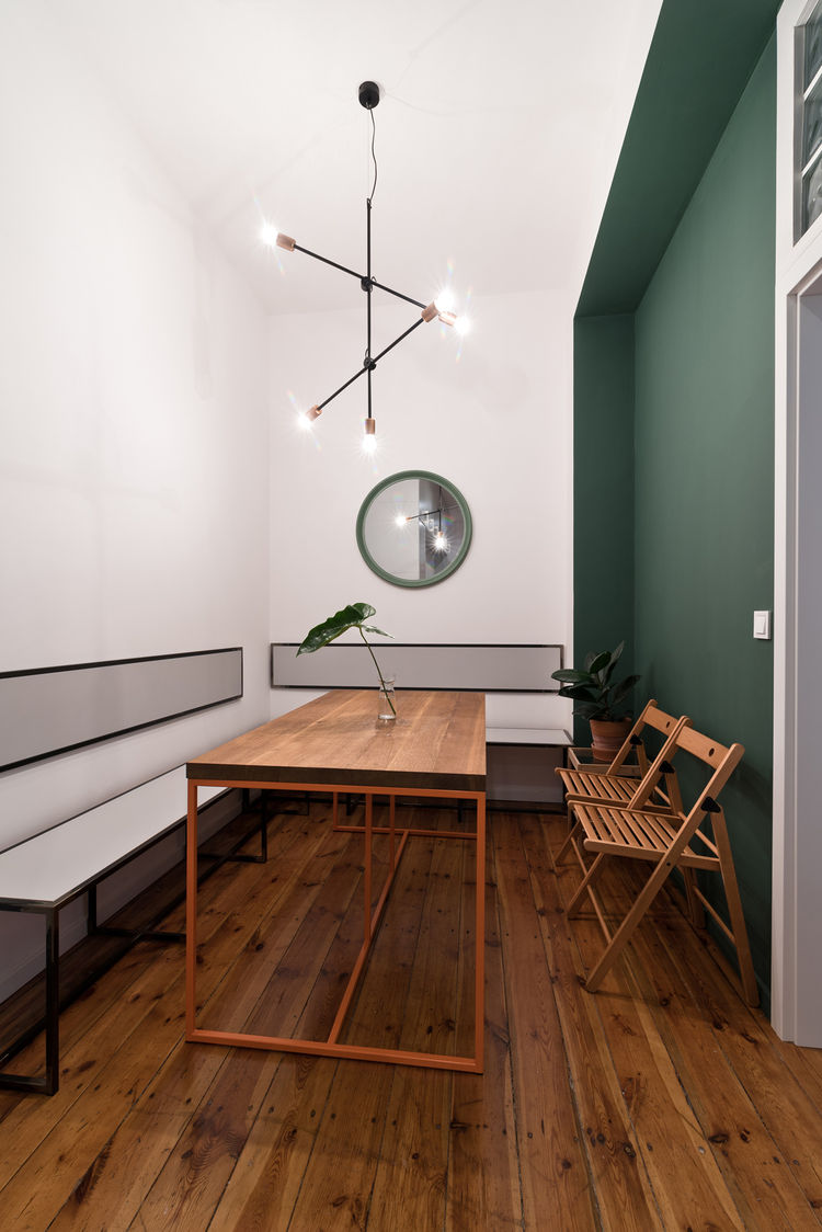 Nowodvorski's Sticks pendant lights in minimalist dining area.