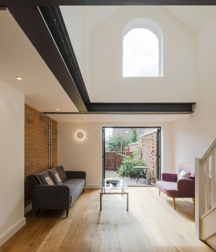 Light-filled double height living room in UK home.