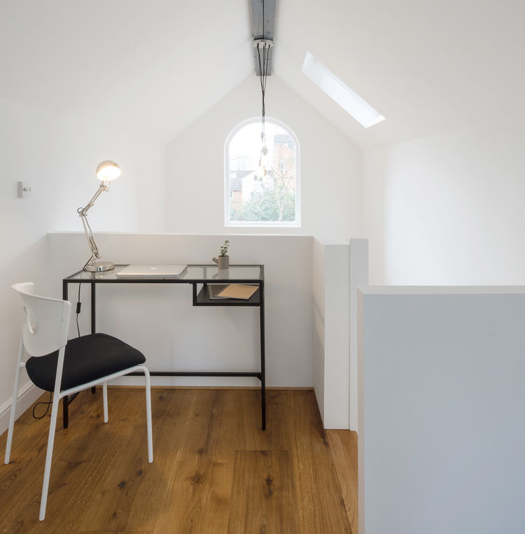 Small mezzanine workspace with views to a rear garden.