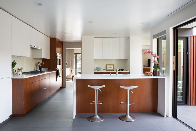Modern kitchen in an Eichler house with mahogany built-ins