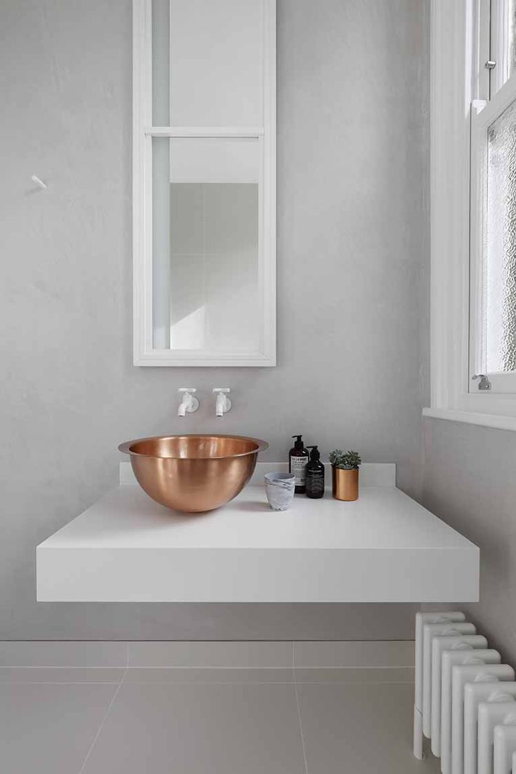 London bathroom with a solid brass bowl sink