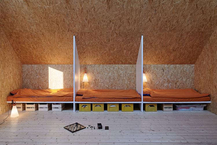 OSB-clad sleeping space in Swedish retreat.