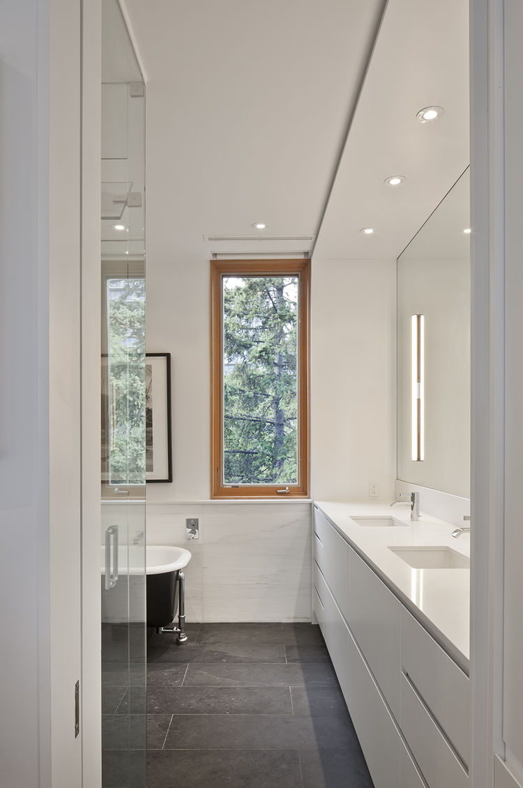 Montauk slate floor and Caesarstone countertops in bathroom of Toronto renovation by Modern Nest Design + Construction.