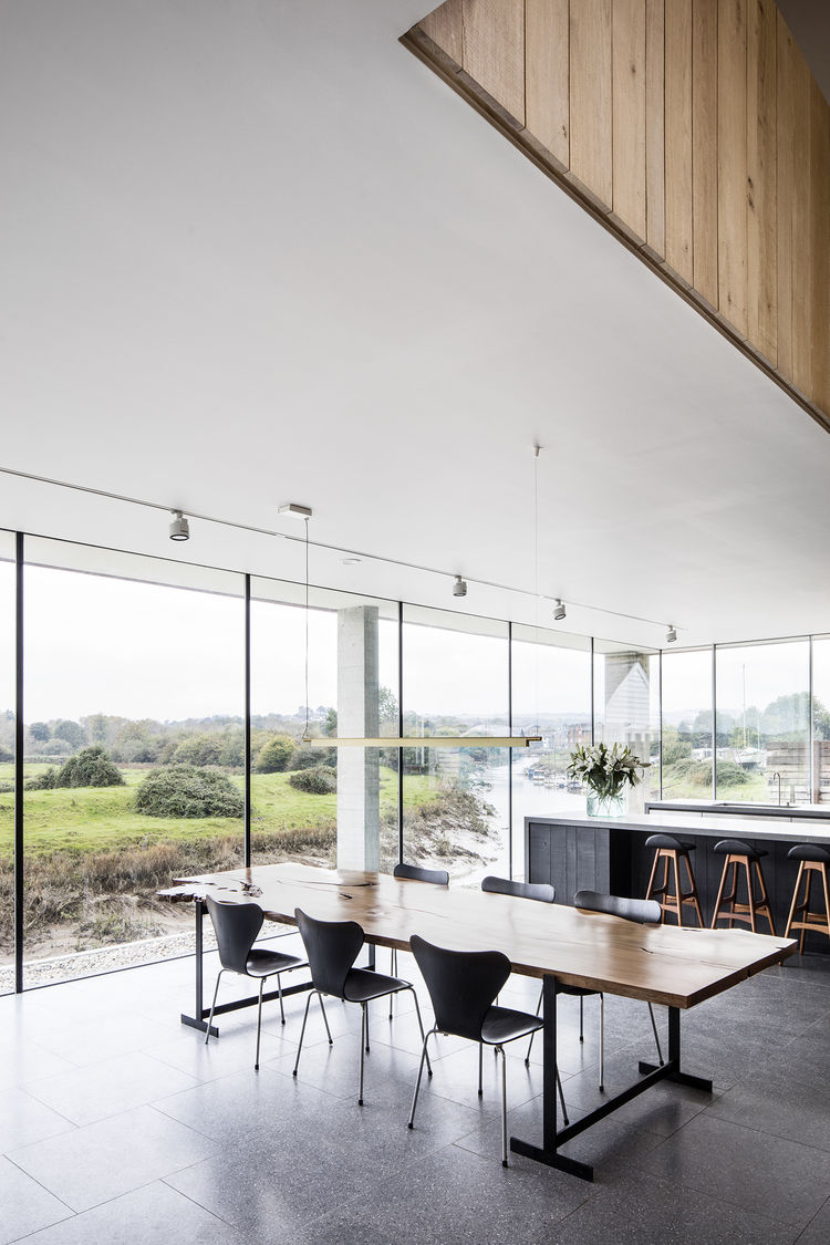 Open-plan dining room with floor-to-ceiling glass