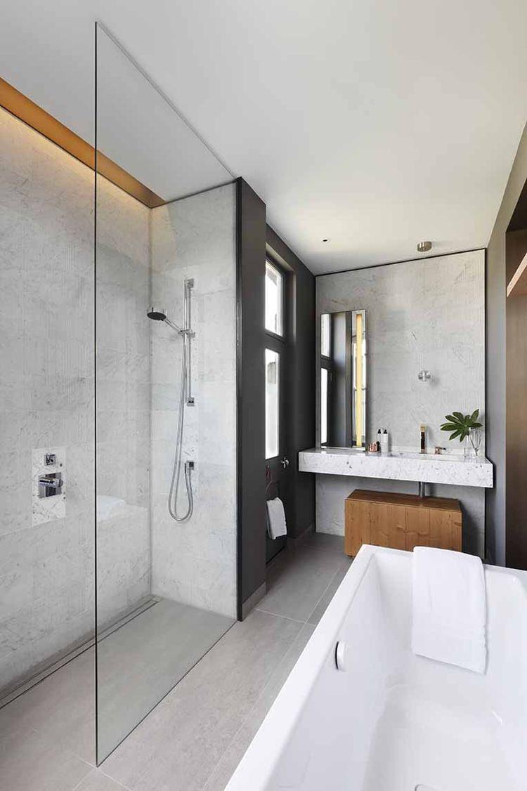 Cleanly minimal master bathroom in London