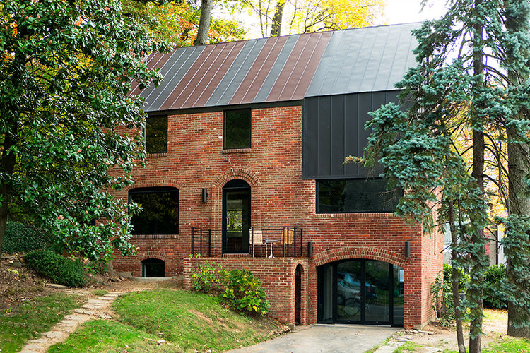 A brick house in Arlington, Virginia, with standing-seam roof