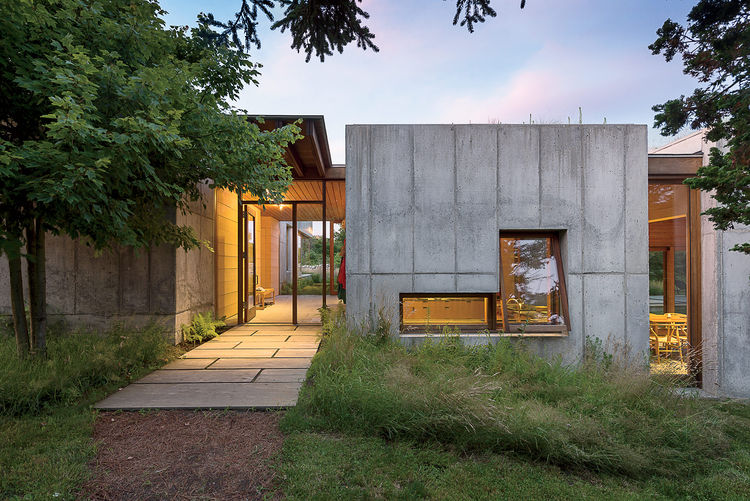 Martha's Vineyard prefab with a thick concrete facade