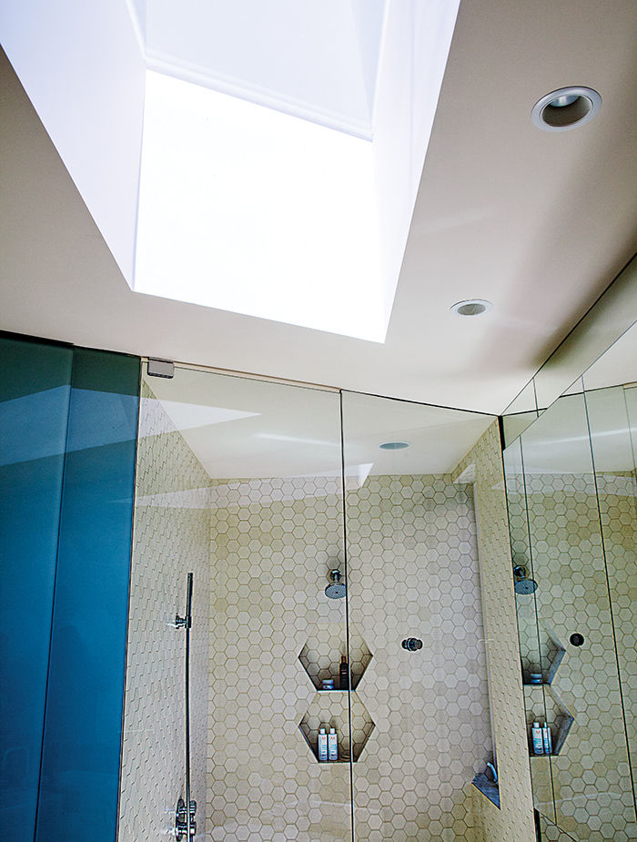 Modern prefab modular and triangular home by HOMB in Portland with hexagonal tiles in the bathroom shower