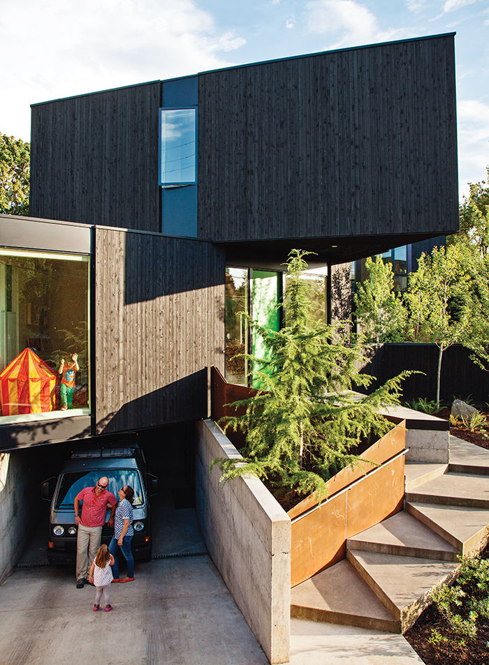 Modern prefab modular and triangular home by HOMB in Portland cantilevered bedroom module, entrance steps, and facade