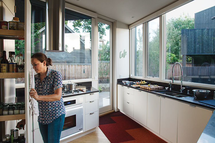 Modern prefab modular and triangular home by HOMB in Portland kitchen with white oak cabinets