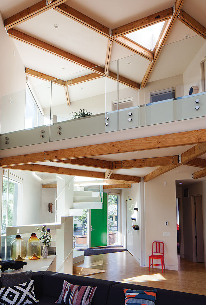 Modern prefab modular and triangular home by HOMB in Portland skylight main space