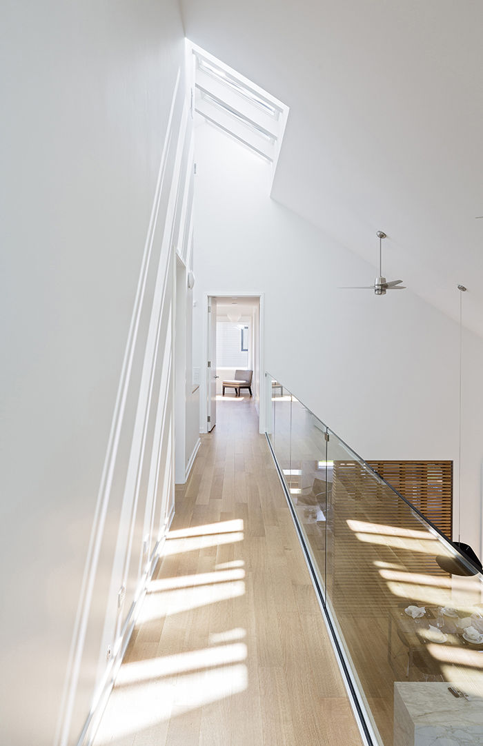Green Toronto prefab hallway with skylights