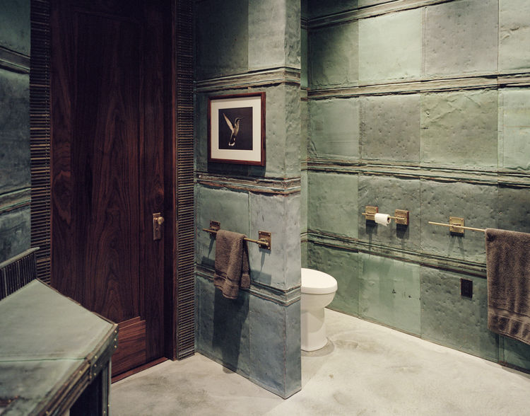 A bathroom full of bronze, copper, and brass accents