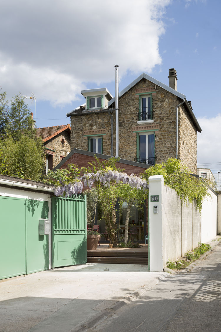 The driveway leads up to a renovated home in France