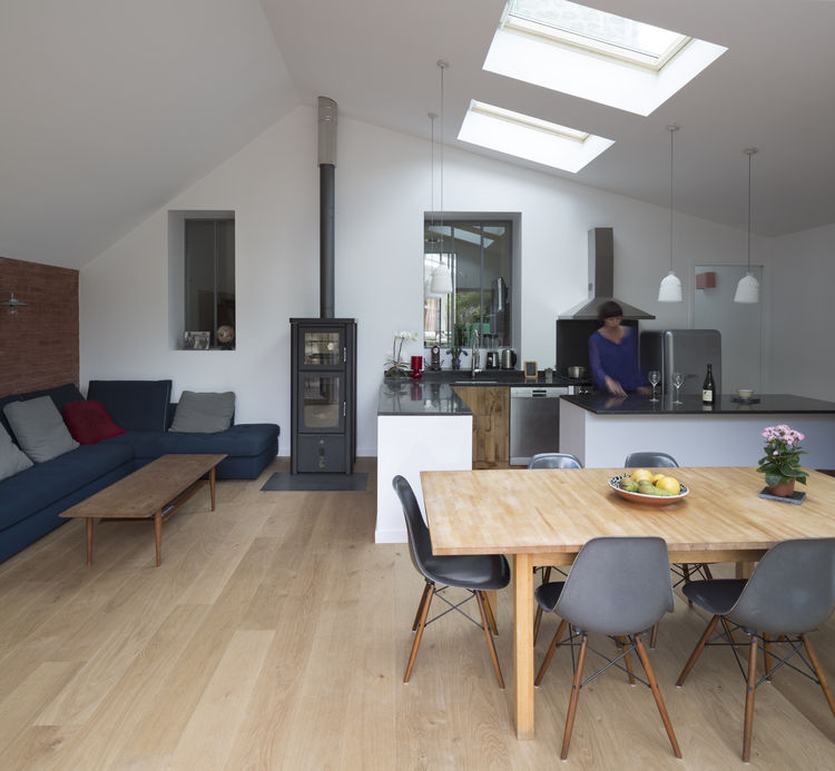This home features a Velux Skylights and a wood stove by Max Blanks