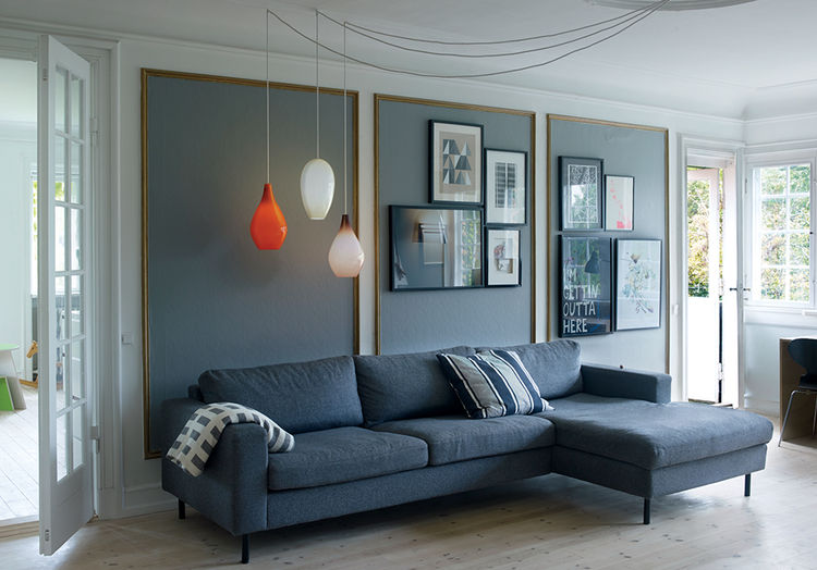 Copenhagen renovation living room with vintage glass pendant lights.