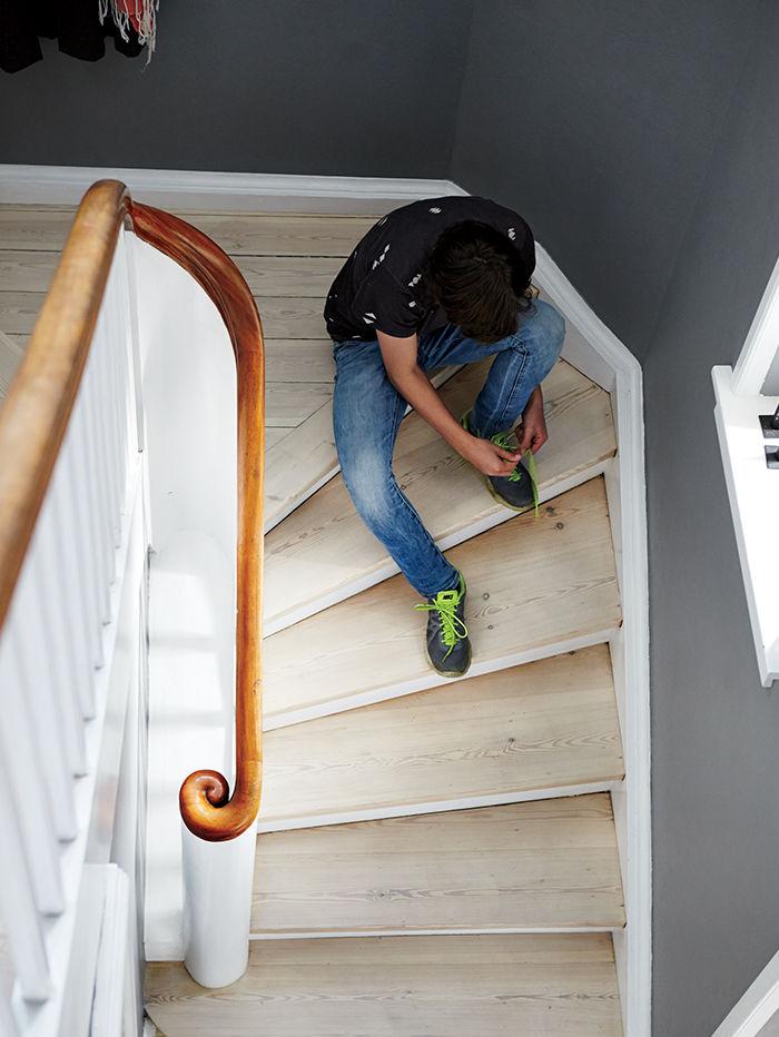 Copenhagen renovation stairwell with white pine boards.