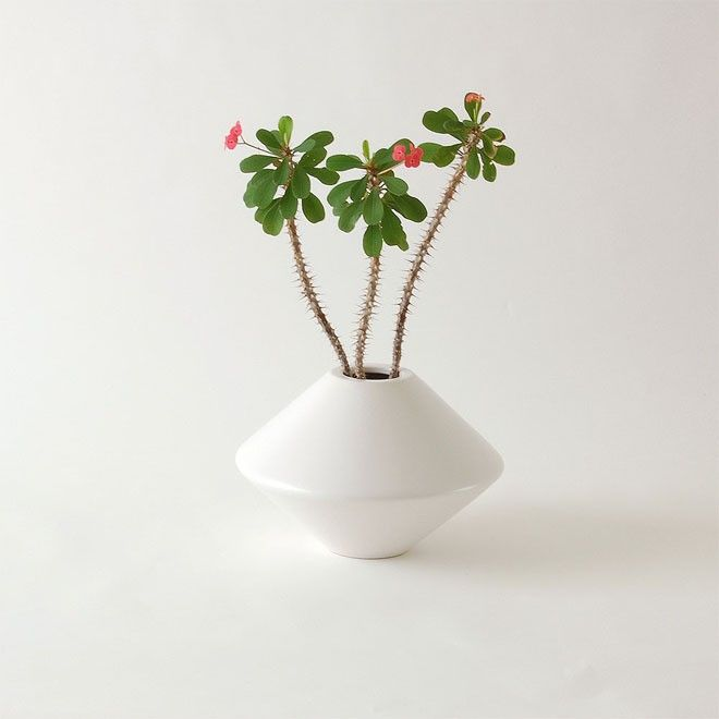 Classic ceramic vase with double conical shape