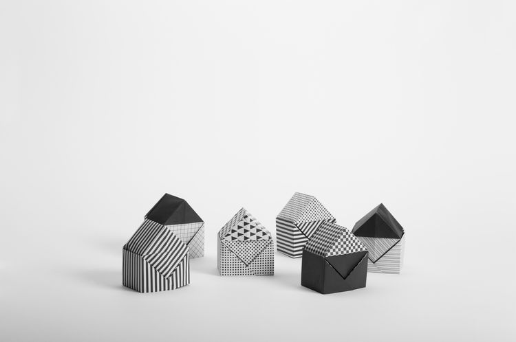 Black and white origami house structures