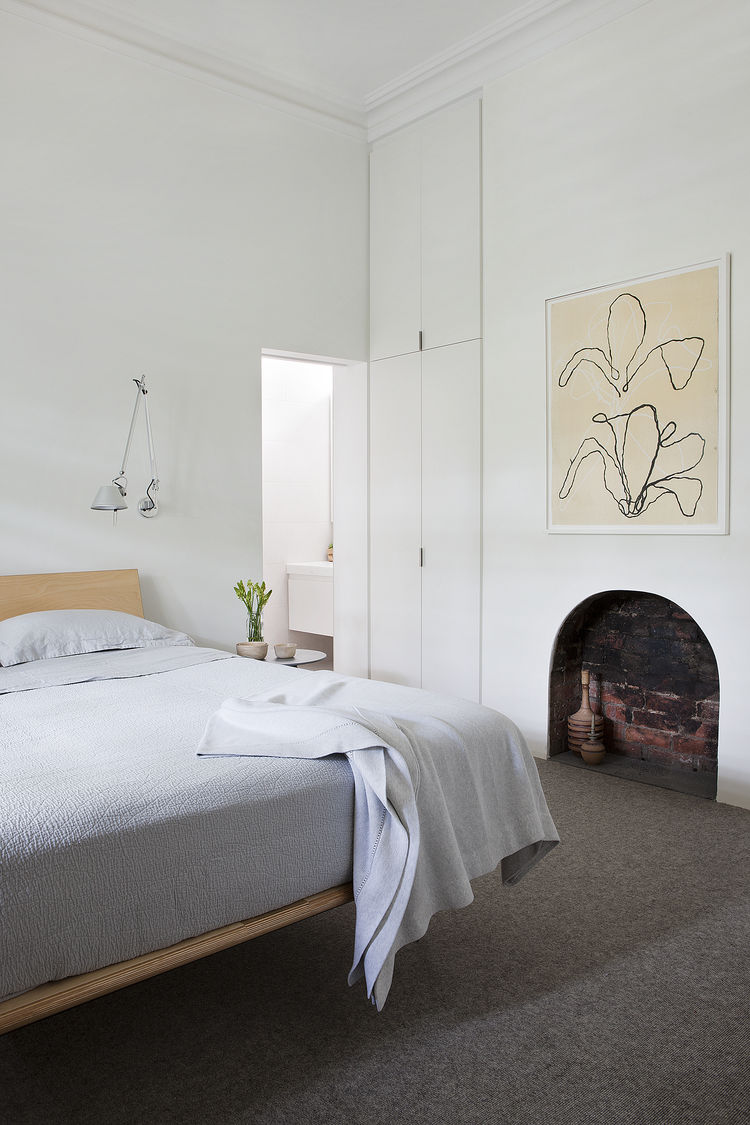 Tolomeo wall mounted lamps and V Leg Bed by George Nelson in Melbourne renovation's bedroom.