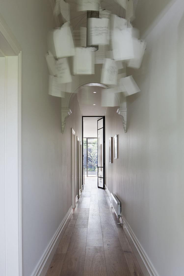 Ingo Maurer Zettel'z 5 chandelier and white smoked oak floors in Melbourne renovation.
