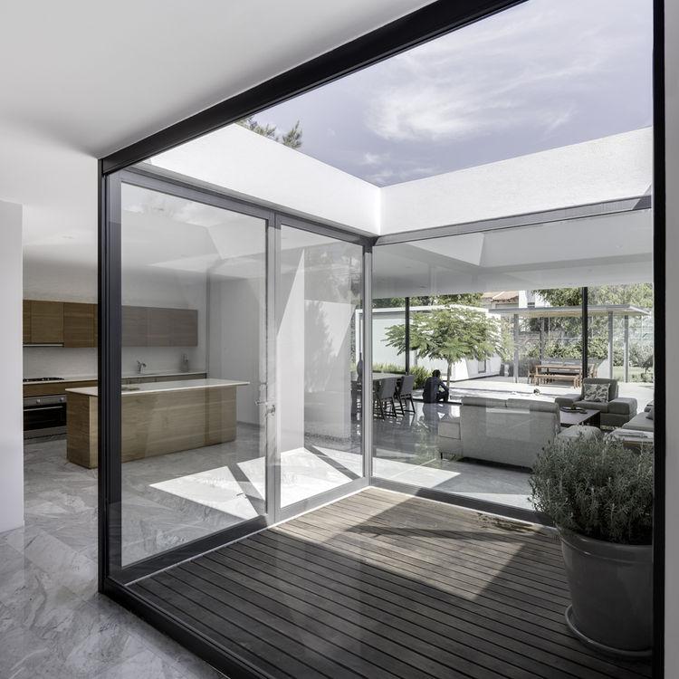 Enclosed atrium and Hector Esrawe furniture in weekend home by Asociacion de Diseno in Mexico.