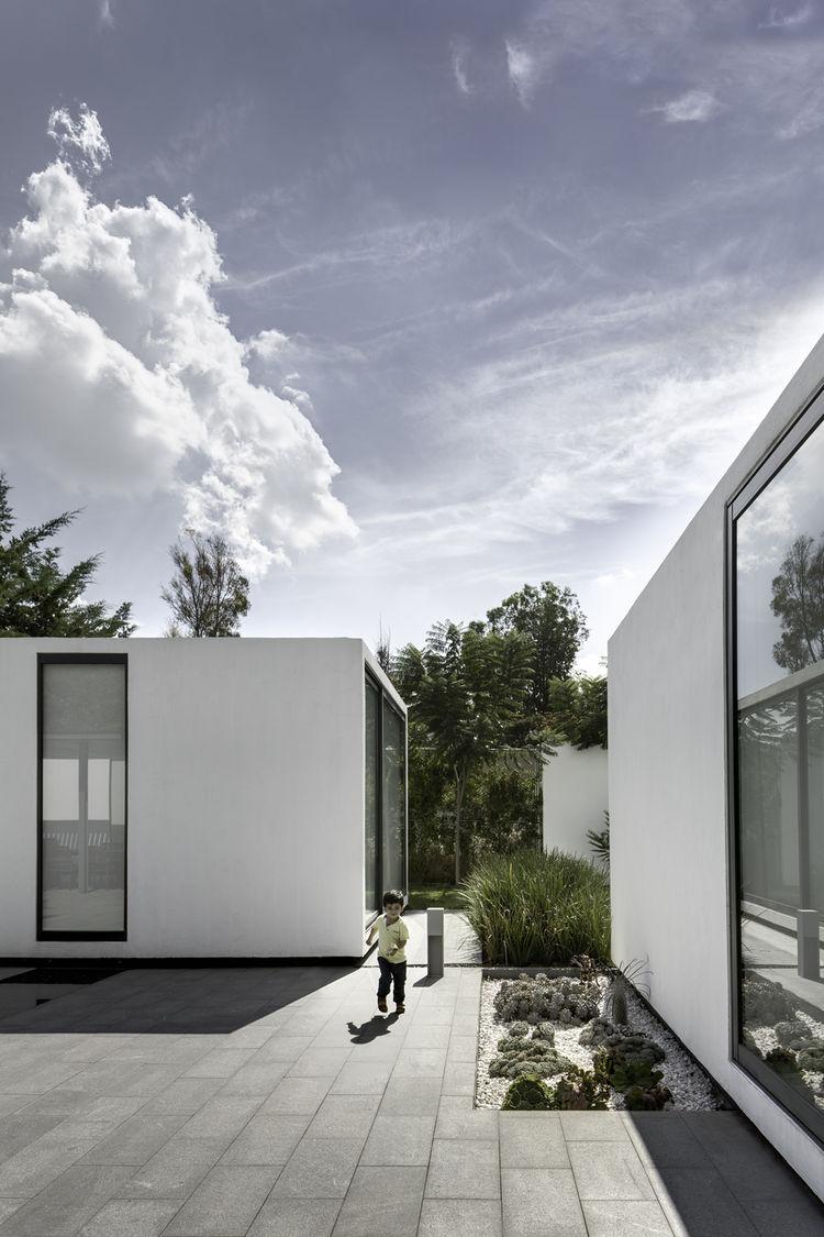 Courtyard and patios of weekend home by Asociacion de Diseno in Mexico.